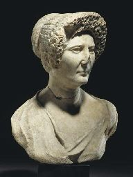 A ROMAN MARBLE PORTRAIT BUST OF A FLAVIAN LADY. FLAVIAN PERIOD, LATE 1ST CENTURY A.D. Finely carved in Greek marble, her head turned slight...
