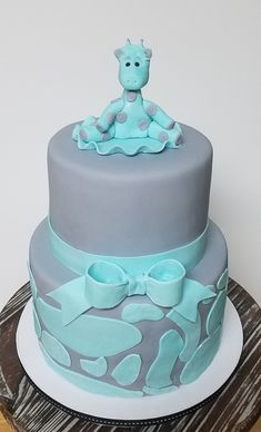 In Teal and Grey, all Dressed up for a baby shower! Giraffe Fondant Baby Shower Cake