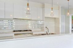 Kitchen pendant lights and mirrored tile splashback