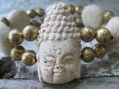 This beautiful Bracelet is made of polymer clay to imitate Ryolite Stone. Antique brass spacer beads add to the beauty of this piece.   For some Buddha has magical meaning.For others it