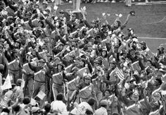 Members of the 573-member U.S. Olympic delegation wave American flags as they respond to the 90,000-plus audience attending the opening ceremonies of the 1984 Summer Games in Los Angeles Memorial Coliseum, Saturday, July 28, 1984. Photo: Anonymous, ASSOCIATED PRESS / AP1984
