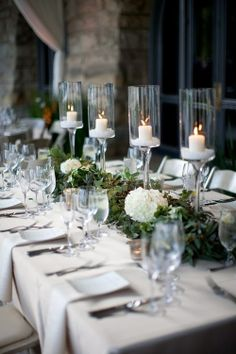 Pretty modern Christmas tablescape with white hydrangeas, tall white candles and winter greenery \\ 50 Stunning Christmas Tablescapes - Christmas Decorating - Style Estate Christmas Table Settings, Christmas Tablescapes, Christmas Table Decorations, Holiday Tables, Holiday Decor, Holiday Dinner, Christmas Party Table, Candle Decorations, Thanksgiving Holiday