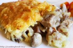 Chicken with mushrooms, baked potato under a fur coat