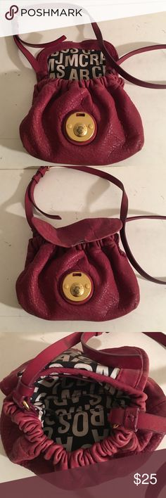 MARC JACOBS CROSSBODY BAG 9 by 7 PREOWNED SIGNS OF WEAR AND DAMAGE TO THE FRONT FLAP WHERE THE CLOSURE PIECE WAS RED PEBBLE GRAIN LEATHER WITH MARC JACOBS LINING. MEASURES 9 INCHES WIDE BY 7 INCHES HIGH MARC JACOBS Bags Crossbody Bags