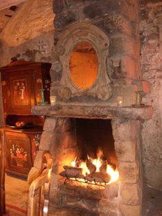 A House Romance - Oeil de Boeuf over fireplace Rustic Fireplaces, Fireplace Mantle, Fireplace Design, Fireplace Ideas, Country Fireplace, Stone Mantle, Cottage Fireplace, Simple Fireplace, Fireplace Heater