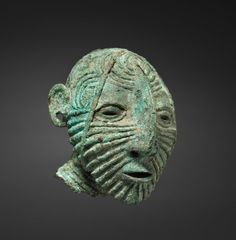 Male Head, c. 1st millenium BC  Thailand, Ban Chiang culture, Neolithic period  bronze, Overall: 8.70 x 7.00 x 8.10 cm  Source: Cleveland Museum of Art