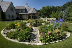 A traditional knot garden provides plenty of color out front and vegetables, herbs and cut flowers for inside the house.