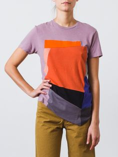 Light mauve tee with a patchwork of colors stitched together. Crew neck with short sleeves. A fun alternative to a classic tee shirt. - 100% Organic Cotton - Made in the USA - Hand wash cold