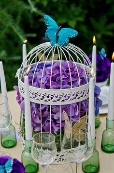 Hydrangea, cage, and butterfly centerpiece. #purple #blue