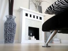 DIY faux fireplace! Genius - I have always been a fan of fireplaces with candles in them.