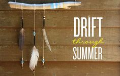 Hang feathers from driftwood