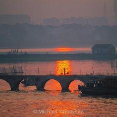 Photograph by Michael Yamashita. @yamashitaphoto. Sunset in Suzhou sets the water of the Grand Canal alight. #Jiangsu #China #sunset #grandcanal @natgeocreative @thephotosociety by natgeo