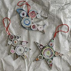 "Newsprint Quilled ornaments Handmade holiday. These Newsprint Quilled Ornaments are handcrafted from recycled paper, adding an artisanal touch to holiday trees. Quilling, or paper filigree, involves rolling strips of paper into intricate patterns and designs.    • Handmade.  • Recycled paper.  • 3.9""w x 3.5""d x .16""h.  • Spot clean.  • Made in India."