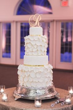 White and gold wedding cake.  Photo by Joel Ross Photography