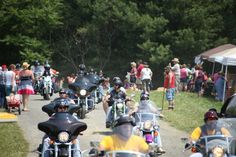 Motorcyclists making their way past the main entrance to the 2nd Annual Bluegrass and BBQ Festival at Chantilly Farm in Floyd, VA. May 2012