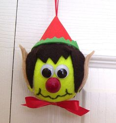 Great little Christmas Elf ornament made from a tennis ball!! What could be better to decorate the tree of your favorite tennis player??  Ornament