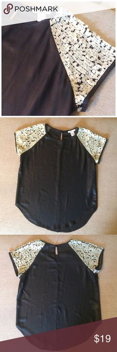 Bar lll sheer black blouse with shoulder detail Beautiful Bar lll sheer black blouse with opaque detailing on the shoulders. 9 inch slit on back bottom. This top is beautiful. I only wore it once before I realized I should have purchase a medium. This is size small. 100 polyester, the black looks slick. Bar III Tops Blouses