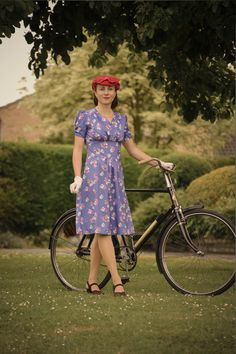 Dress made from a 1940s pattern with self designed fabric, 1940s shoes, vintage hat, gloves and bike.