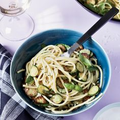 Gwyneth Paltrow's fried-zucchini pasta combines crispy zucchini coins with spaghetti. It's coated with a creamy sauce of Parmesan cheese, olive oil and basil.
