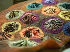 THE FABRIC OF MEDITATION - SARA LECHNER'S BLOG: Barnacle throw Interesting way to add texture. Done with an embellisher.