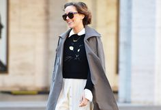Looking purrrfect paired with a cute skirt and great shades.