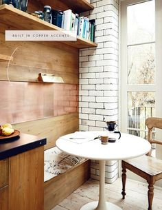 a metallic panel in a wood built in for this breakfast nook adds beautiful detail - coco kelley in the details