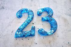Street numbers https://www.etsy.com/listing/195651843/two-or-more-decorative-numbers-in