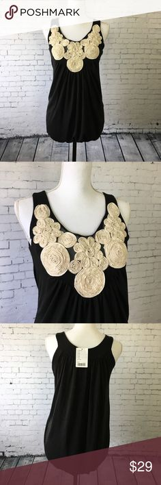 "🦄Urban Outfitters Kimchi Rose Appliqué Tank Tank blouse from Urban Outfitters by Kimchi Blue. Black with white Appliqué roses are so dainty and fun! Pair with denim jeans or shorts. Size L. New with tags. Original $48. Polyester and Rayon. Approx 24"" long. Urban Outfitters Tops Blouses"