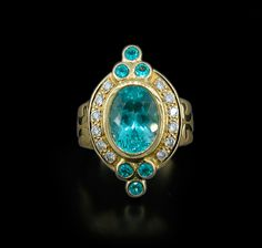 Paula Crevoshay Paraiba Tourmaline and Diamond Ring ~ 3.73 Carats of Paraiba and 0.37 carats of Diamonds in this stunning ring, set in 18K Yellow Gold.