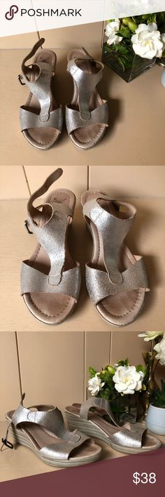 ✨Silver Metallic KMB Anthropologie Wedge Sandals✨ Metallic silver and tan KMB wedge sandals from Anthropologie. These are made in Spain and the tops are genuine leather. They have a naturally worn crackled metallic texture on the leather, and fit like a true 6. These are super cute, I just never ended up wearing them and need to clear out my closet. Perfect for Spring!🌿✨ 🚫No trades please Anthropologie Shoes Wedges