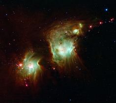 Looking like a pair of eyeglasses only a rock star would wear, this nebula brings into focus a murky region of star formation. NASA's Spitzer Space Telescope exposes the depths of this dusty nebula with its infrared vision, showing stellar infants that are lost behind dark clouds when viewed in visible light.