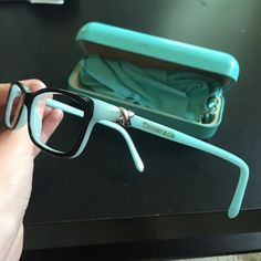 Tiffany & Co eyeglasses TF2036 Beautiful Tiffany and Co eyeglasses! Style TF2036 Black with blue on the inside. These do not include prescription lenses. Ready for you to take and get your own prescription filled! Comes with Tiffany case (although it's had some wear and tear). Glasses are eye size 52. Bridge size 15. Temple length 135. Tiffany & Co. Accessories Glasses