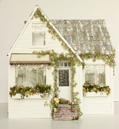 http://www.cinderellamoments.com/2017/02/sunny-side-up-custom-dollhouse.html