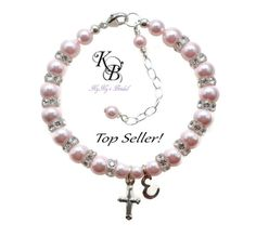 This is our Best Selling Baptism Bracelet. It comes in your choice of over 40 beautiful Swarovski pearl colors, spaced with hard to find Swarovski transparent crystal rondelles. The cross, claps and extender chain are .925 sterling silver and baby's initial charm is a sterling silver script font letter. Makes a loving keepsake to be treasured forever. Shop Now! #baptism #christening #baby #babygift #cross #personalized
