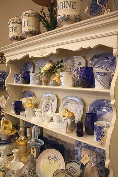 Pretty white hutch with blue and white china and glass ware plus the added bonus of YELLOW!