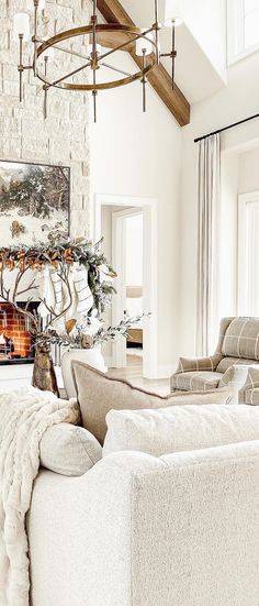 Looking for Farmhouse Christmas Decorating Ideas? Warm up with faux fur and set your style aglow. With the softest layers of texture, fresh winter whites and merry metallic touches, you can create a farmhouse holiday look that's both effortless and enchanting | Designed by Ourfauxfarmhouse on Instagram. #christmas #christmasideas #farmhouse #farmhousechristmas #farmhousedecor