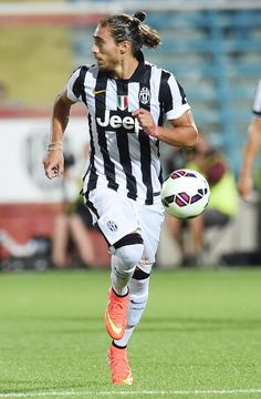 Martin Caceres of Juventus in action during the preseason friendly...