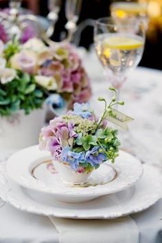 spring table. find sweet cups at second hand stores and use as favors for guests