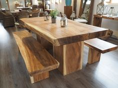 Magnificently elegant Suar Wood solid dining table, incredible individuality in the colour of the wood. Constructed from a solid trunk of Suar, this item creates a real statement. The shade varies greatly between the centre and outer edges of the tree, creating a striking and stunning multi-coloured crafted wood table.