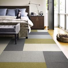Flor carpet tiles, I believe. Looks great in these colours and layout