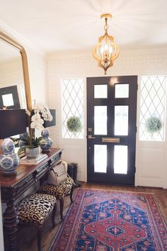 Your entryway is the first chance you have to make your guests feel welcome and to set the tone for your home overall. Here are my 5 tips for creating an inviting and bold entry!