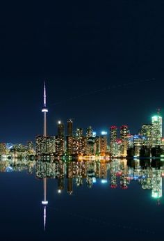 Midnight Toronto from Central Island.The dot line is an airplane. - Sergey Eiderman