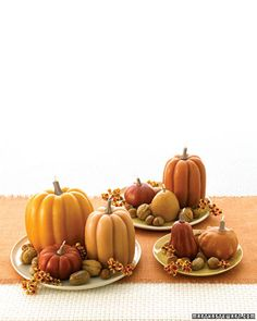 Pumpkin Candles  A molded candle can light up a room even after the flame is out. These arrangements draw from the natural beauty of the season, whether the candles are whimsical or realistic. They're ideal as a fall centerpiece.