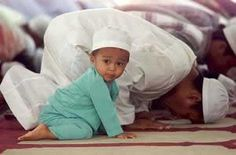 muslims praying it's just shows  Our children, watch what we do always