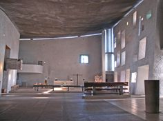 Romchamp Church, Le Corbusier 1954 - The gaps in the walls and light wood furniture all systems adhere to the size of the architect Modulor. Stained glass by Le Corbusier also installed.