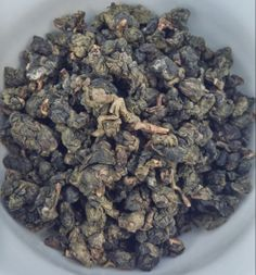 Jing Shuan Thai Oolong Tea Dry Leaves. Now available for purchase at http://www.teajourneymanshop.com!