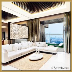 Pile up pillows on your living room sofas. Use two pairs, in contrasting patterns, colours, and textures. #BetterHomes