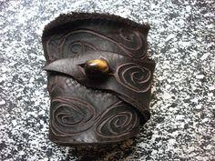 Brown Leather Wrist Cuff w/ Swirls by TreadLightGear on Etsy, via Etsy.