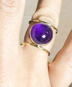 Modern Round Silver or Bronze Double Ring with Amethyst Gem Stone Handmade amethyst ring. Round amethyst gemstone sits beautifully in handmade bezel. The band is made of round wire that catches and reflects the light beautifully. It has a smooth and comfortable finish. Ring fits well on all fingers.   Ring can be handcrafted from sterling silver and bronze. Photos include the bronze version