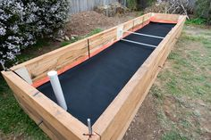 Geotex fabric layer in wicking beds